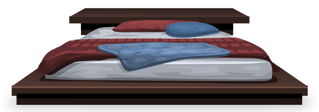 Bed with mattress and pillows
