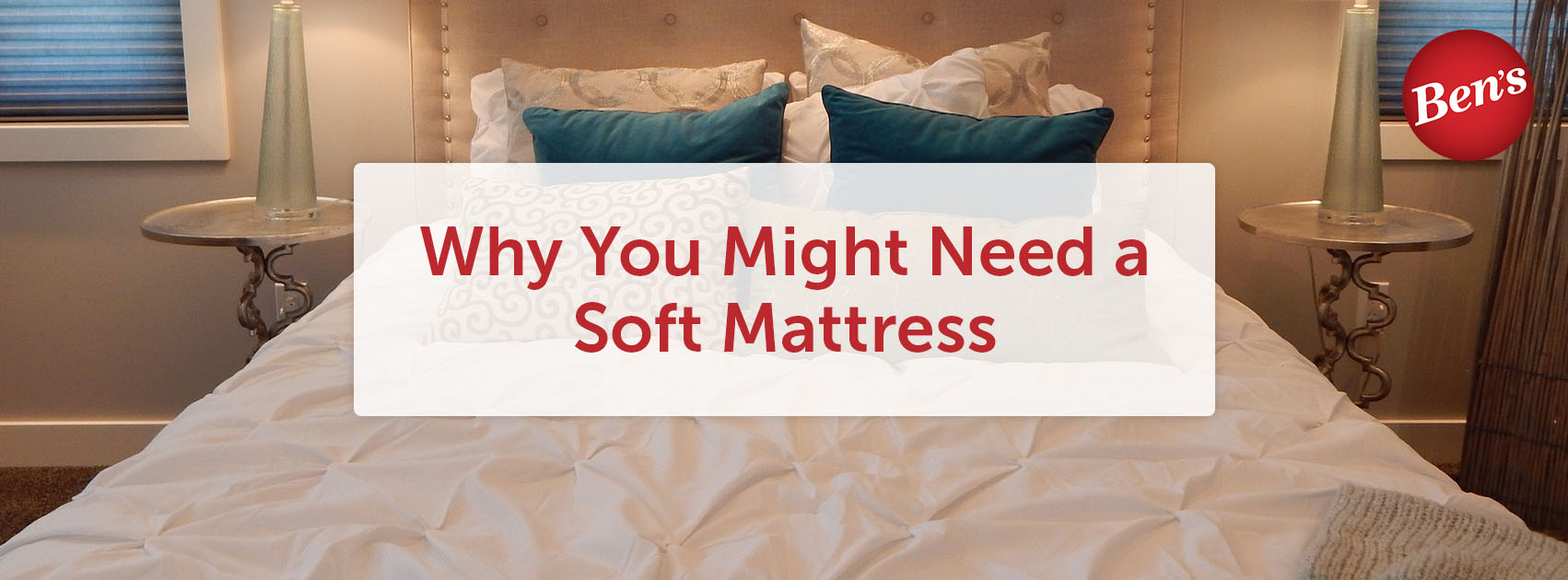 Soft mattress with white sheets and blue pillows in a bedroom.